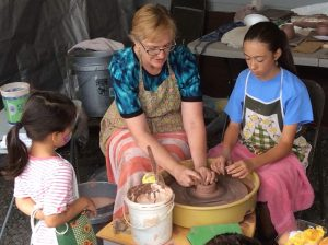 Cathie Miranda teaching pottery skills